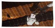 An Astronaut Anchored To A Foot Beach Towel