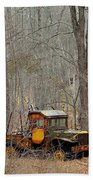 An Old Truck In The Woods. Beach Towel