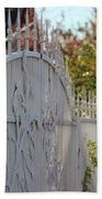 Angled Closeup Of White Washed Iron Gate To Garden Beach Towel