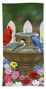 The Colors Of Spring - Bird Fountain In Flower Garden Beach Towel by Crista Forest