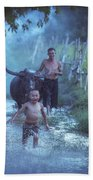 Asian Boy Playing Water With Dad And Buffalo Beach Towel
