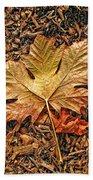 Autumn's Textured Maple Leaf Beach Towel