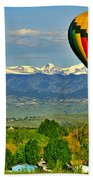 Ballooning Over The Rockies Beach Towel by Scott Mahon
