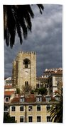 Bell Tower Against Roiling Sky Beach Towel