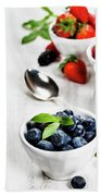 Berries In Bowls  On Wooden Background. Beach Towel