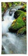 Betwixt The Mossy Rocks Beach Towel