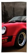 Black Forest - Red Speedster Beach Towel by Douglas Pittman