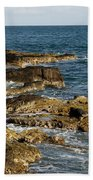 Black Rock Point And Sailboat Beach Towel