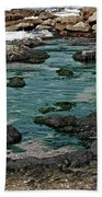 Black Rocks On Blue Water Beach Towel