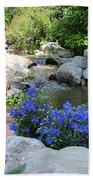 Blue Flowers And Stream Beach Towel