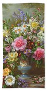 Bluebells Daffodils Primroses And Peonies In A Blue Vase Beach Towel