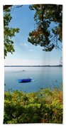 Boat Framed By Trees And Foliage Beach Towel