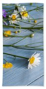 Bouquet Of Wild Flowers On A Wooden Beach Towel