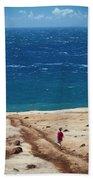 Boy Runs Toward Ocean Beach Towel