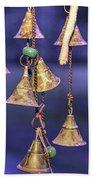 Brass Bells Hanging In The Illuminated Courtyard At Winter Night Beach Towel