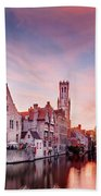 Bruges Sunset Beach Towel by Barry O Carroll