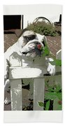 Bulldog Sniffing Flower At Garden Fence Beach Towel