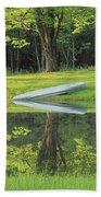Canoe At Ponds Edge Beach Towel