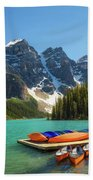 Canoes On A Jetty At  Moraine Lake In Banff National Park, Canada Beach Towel