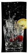Cherries Splashing Into Sparkling Water Glass With Lemon Slice O Beach Towel