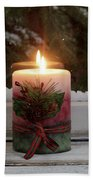 Christmas Candle Glowing On Window Sill With Snowy Evergreen Bra Beach Towel