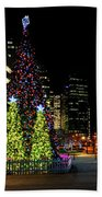 Christmas Tree On New Year's Eve In The Street Of A Big City Beach Towel