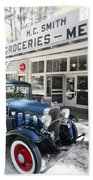 Classic Chevrolet Automobile Parked Outside The Store Beach Towel
