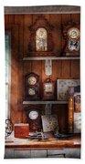 Clocksmith - In The Clock Repair Shop Beach Towel by Mike Savad