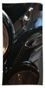Close Up On Black Shining Car Round Light Beach Sheet