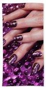 Closeup Of Woman Hands With Purple Nail Polish Beach Sheet