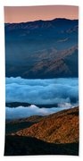 Clouds In The Valley Beach Towel