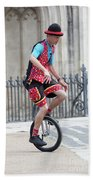 Clown Riding Unicycle In Town Beach Towel
