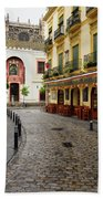 Cobblestone Argote De Molina Street With Cafe Ending At The Nort Beach Towel