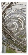Coiled Razor Wire On Fence Beach Towel