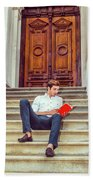 College Student Reading Red Book, Sitting On Stairs, Relaxing Ou Beach Towel