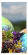 Colored Easter Eggs In Basket And Spring Flowers Beach Towel