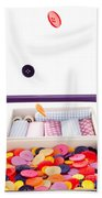 Colorful Buttons Fall Into A Sewing Box Beach Towel