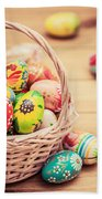 Colorful Hand Painted Easter Eggs In Basket And On Wood Beach Towel
