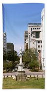 Confederate Monument With Buildings Beach Towel