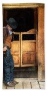 Cowboy By Saloon Doors Beach Towel
