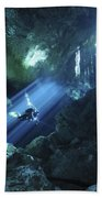 Diver Silhouetted In Sunrays Of Cenote Beach Towel