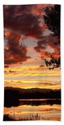 Dramatic Sunset Reflection Beach Towel