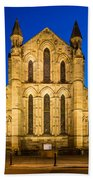 East Side Of Hexham Abbey At Night Beach Towel