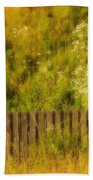 Fence And Hillside Of Wildflowers On Suomenlinna Island In Finland Beach Towel
