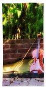 Fiddle On The Garden Wall Beach Towel