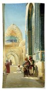 Figures In A Street Before A Mosque Beach Towel
