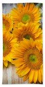 Five Moody Sunflowers Beach Towel