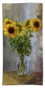 Five Sunflowers Centered Beach Towel by Lois Bryan