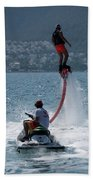 Flyboarder In Pink Shorts Above Jet Ski Beach Towel