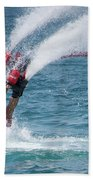 Flyboarder In Red Entering Water With Spray Beach Towel